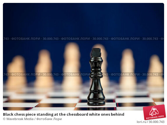 Купить «Black chess piece standing at the chessboard white ones behind», фото № 30000743, снято 28 февраля 2012 г. (c) Wavebreak Media / Фотобанк Лори