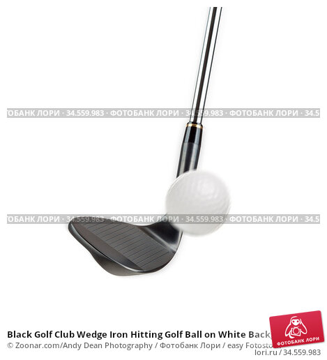 Black Golf Club Wedge Iron Hitting Golf Ball on White Background. Стоковое фото, фотограф Zoonar.com/Andy Dean Photography / easy Fotostock / Фотобанк Лори