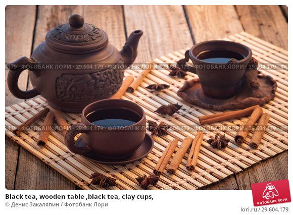 Купить «Black tea, wooden table ,black tea, clay cups,», фото № 29604179, снято 20 апреля 2019 г. (c) Денис Закаляпин / Фотобанк Лори