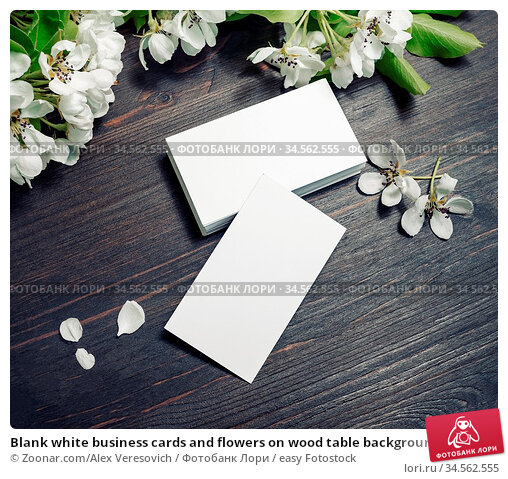 Blank white business cards and flowers on wood table background. Mockup... Стоковое фото, фотограф Zoonar.com/Alex Veresovich / easy Fotostock / Фотобанк Лори