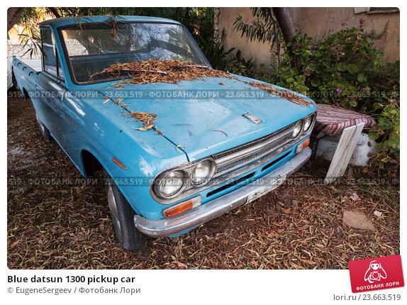 Купить «Blue datsun 1300 pickup car», фото № 23663519, снято 16 августа 2016 г. (c) EugeneSergeev / Фотобанк Лори