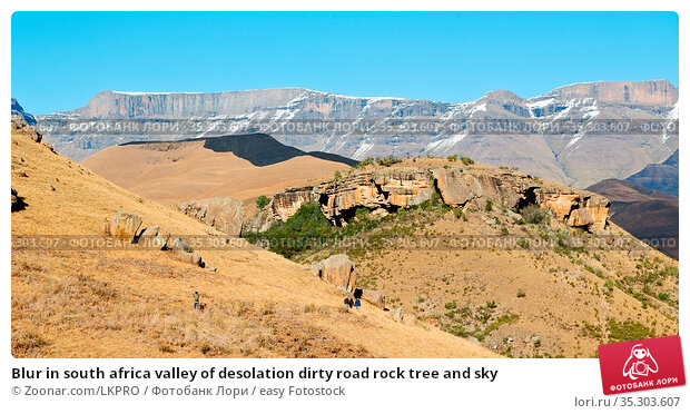 Blur in south africa valley of desolation dirty road rock tree and sky. Стоковое фото, фотограф Zoonar.com/LKPRO / easy Fotostock / Фотобанк Лори