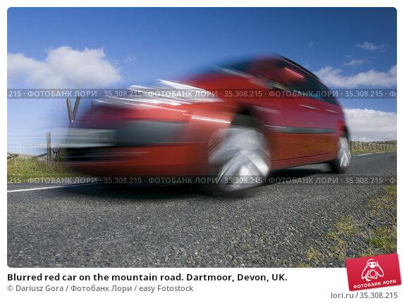 Blurred red car on the mountain road. Dartmoor, Devon, UK. Стоковое фото, фотограф Dariusz Gora / easy Fotostock / Фотобанк Лори
