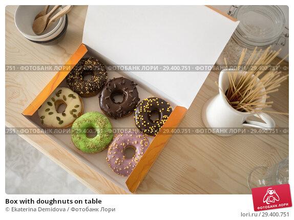 Купить «Box with doughnuts on table», фото № 29400751, снято 6 ноября 2018 г. (c) Ekaterina Demidova / Фотобанк Лори