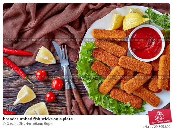 Купить «breadcrumbed fish sticks on a plate», фото № 29305899, снято 22 октября 2018 г. (c) Oksana Zh / Фотобанк Лори