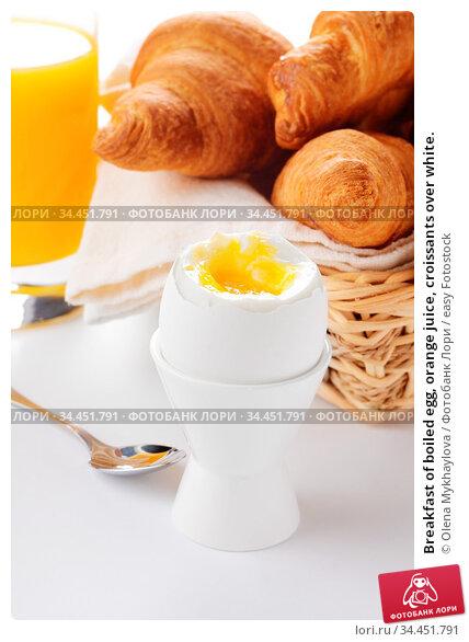 Breakfast of boiled egg, orange juice, croissants over white. Стоковое фото, фотограф Olena Mykhaylova / easy Fotostock / Фотобанк Лори