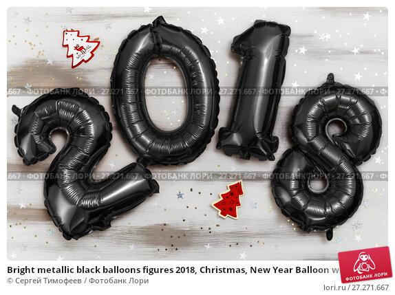 Купить «Bright metallic black balloons figures 2018, Christmas, New Year Balloon with glitter stars on white wood table background», фото № 27271667, снято 19 ноября 2017 г. (c) Сергей Тимофеев / Фотобанк Лори