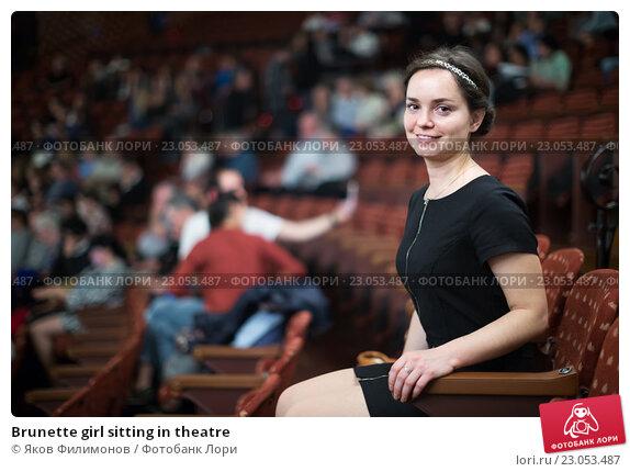 Купить «Brunette girl sitting in theatre», фото № 23053487, снято 2 июня 2020 г. (c) Яков Филимонов / Фотобанк Лори