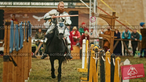 BULGAR, RUSSIA 11-08-2019: Knight riding through the path and takes the ring from the fence. Редакционное видео, видеограф Константин Шишкин / Фотобанк Лори