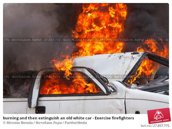 Купить «burning and then extinguish an old white car - Exercise firefighters», фото № 27857775, снято 1 апреля 2019 г. (c) PantherMedia / Фотобанк Лори