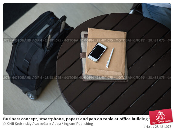 Купить «Business concept, smartphone, papers and pen on table at office building or airport», фото № 28481075, снято 20 июля 2014 г. (c) Ingram Publishing / Фотобанк Лори