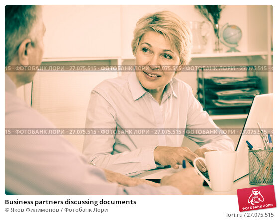 Business partners discussing documents, фото № 27075515, снято 23 октября 2017 г. (c) Яков Филимонов / Фотобанк Лори