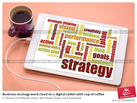 Business strategy word cloud on a digital tablet with cup of coffee. Стоковое фото, фотограф Zoonar.com/Marek Uliasz / easy Fotostock / Фотобанк Лори