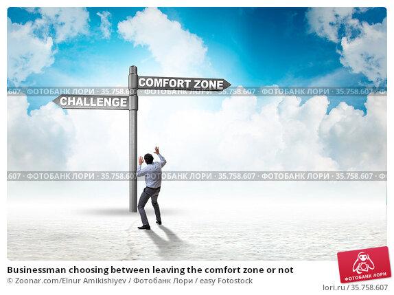 Businessman choosing between leaving the comfort zone or not. Стоковое фото, фотограф Zoonar.com/Elnur Amikishiyev / easy Fotostock / Фотобанк Лори