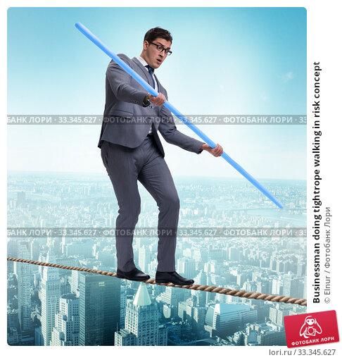 Купить «Businessman doing tightrope walking in risk concept», фото № 33345627, снято 6 сентября 2010 г. (c) Elnur / Фотобанк Лори