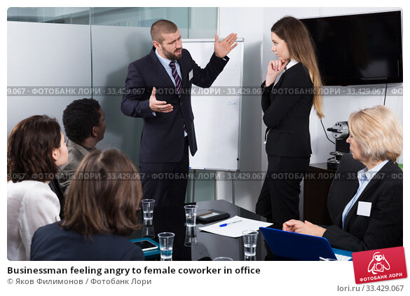 Купить «Businessman feeling angry to female coworker in office», фото № 33429067, снято 12 февраля 2018 г. (c) Яков Филимонов / Фотобанк Лори