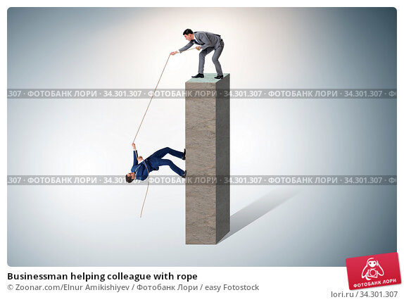 Businessman helping colleague with rope. Стоковое фото, фотограф Zoonar.com/Elnur Amikishiyev / easy Fotostock / Фотобанк Лори