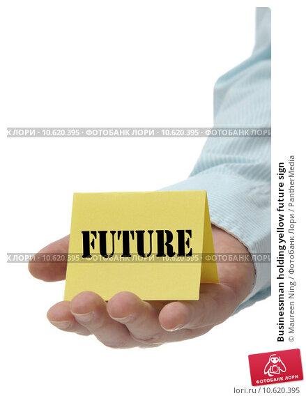 Businessman holding yellow future sign. Стоковое фото, фотограф Maureen Ning / PantherMedia / Фотобанк Лори