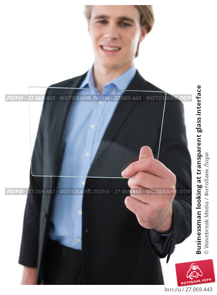 Businessman looking at transparent glass interface, фото № 27069443, снято 6 июня 2017 г. (c) Wavebreak Media / Фотобанк Лори