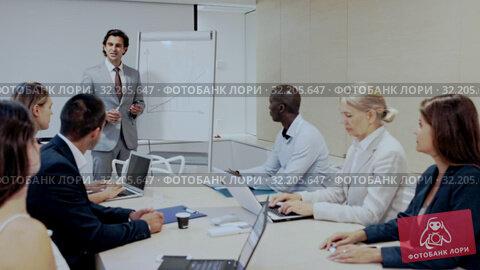 Купить «Businessman making presentation on staff meeting at office», видеоролик № 32205647, снято 17 ноября 2019 г. (c) Яков Филимонов / Фотобанк Лори