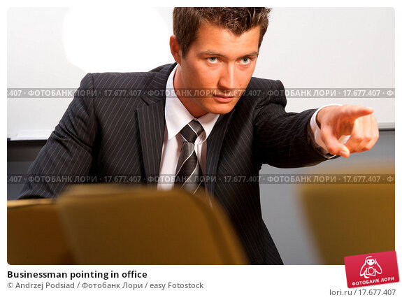 businessman pointing in office