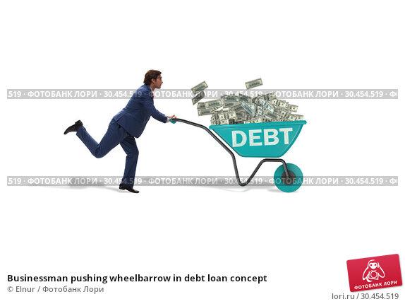 Businessman pushing wheelbarrow in debt loan concept. Стоковое фото, фотограф Elnur / Фотобанк Лори