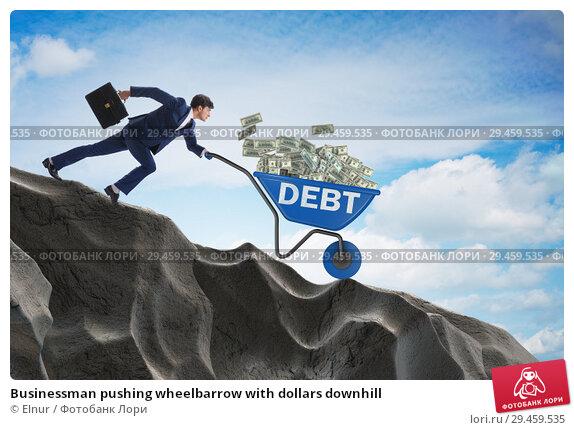 Купить «Businessman pushing wheelbarrow with dollars downhill», фото № 29459535, снято 12 ноября 2019 г. (c) Elnur / Фотобанк Лори