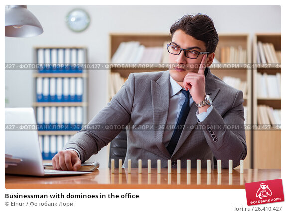 Купить «Businessman with dominoes in the office», фото № 26410427, снято 31 января 2017 г. (c) Elnur / Фотобанк Лори