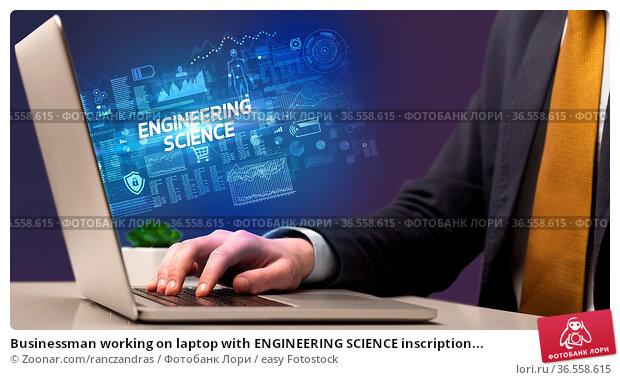 Businessman working on laptop with ENGINEERING SCIENCE inscription... Стоковое фото, фотограф Zoonar.com/ranczandras / easy Fotostock / Фотобанк Лори
