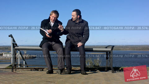 Купить «Businesspeople having Informal Meeting.», видеоролик № 28574847, снято 12 октября 2015 г. (c) Vasily Alexandrovich Gronskiy / Фотобанк Лори