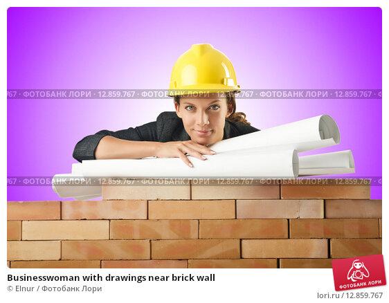 Купить «Businesswoman with drawings near brick wall», фото № 12859767, снято 27 июля 2012 г. (c) Elnur / Фотобанк Лори
