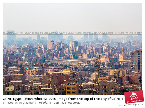 Купить «Cairo, Egypt – November 12, 2018: Image from the top of the city of Cairo, the capital of Egypt, And it's showing some residential buildings.», фото № 29630187, снято 12 ноября 2018 г. (c) age Fotostock / Фотобанк Лори