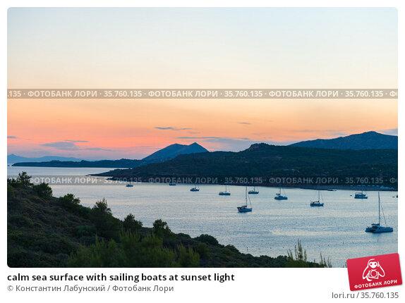 calm sea surface with sailing boats at sunset light. Стоковое фото, фотограф Константин Лабунский / Фотобанк Лори
