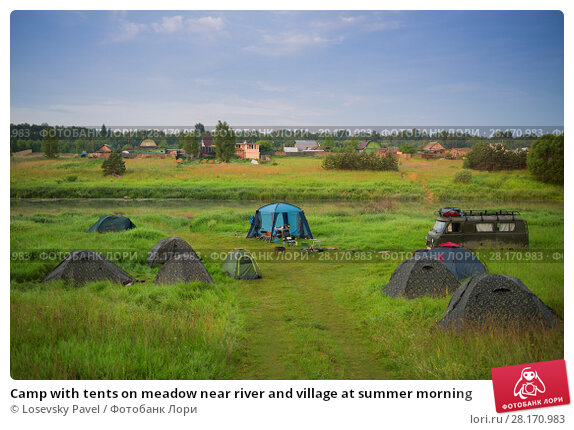 Купить «Camp with tents on meadow near river and village at summer morning», фото № 28170983, снято 2 июля 2016 г. (c) Losevsky Pavel / Фотобанк Лори
