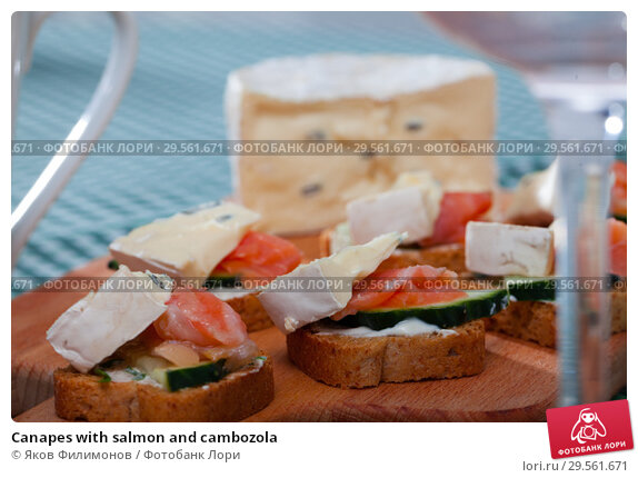 Купить «Canapes with salmon and cambozola», фото № 29561671, снято 23 февраля 2019 г. (c) Яков Филимонов / Фотобанк Лори
