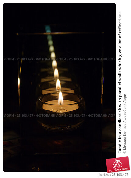 Купить «Candle in a candlestick with parallel walls which give a lot of reflections», фото № 25103427, снято 12 декабря 2016 г. (c) Михаил Кочиев / Фотобанк Лори