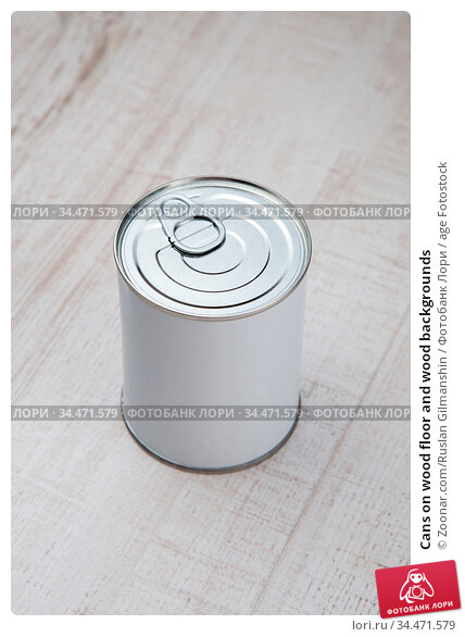 Cans on wood floor and wood backgrounds. Стоковое фото, фотограф Zoonar.com/Ruslan Gilmanshin / age Fotostock / Фотобанк Лори