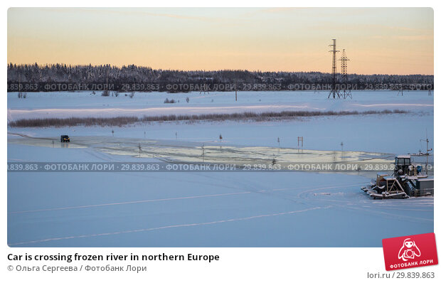 Купить «Car is crossing frozen river in northern Europe», фото № 29839863, снято 4 января 2016 г. (c) Ольга Сергеева / Фотобанк Лори