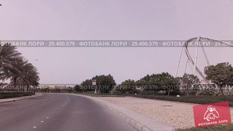 Купить «Car trip to the Ferrari World Yas Island in Abu Dhabi stock footage video», видеоролик № 29400579, снято 3 апреля 2018 г. (c) Юлия Машкова / Фотобанк Лори