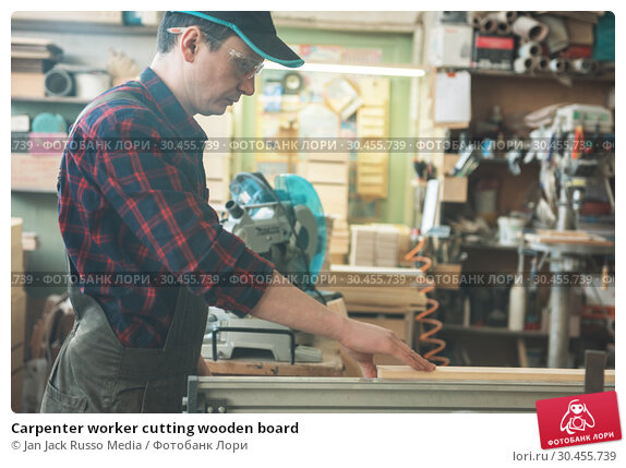 Carpenter worker cutting wooden board. Стоковое фото, фотограф Jan Jack Russo Media / Фотобанк Лори