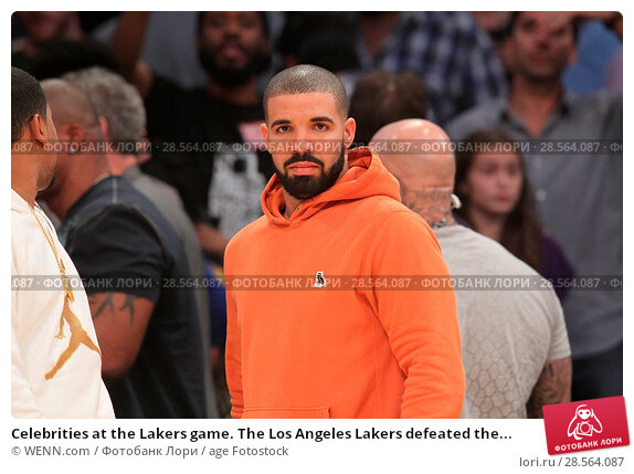 Купить «Celebrities at the Lakers game. The Los Angeles Lakers defeated the Golden State Warriors by the final score of 117-97 at Staples Center in downtown Los...», фото № 28564087, снято 4 ноября 2016 г. (c) age Fotostock / Фотобанк Лори