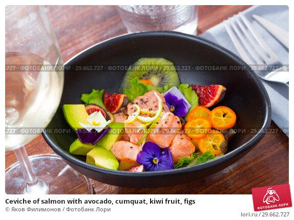 Купить «Ceviche of salmon with avocado, cumquat, kiwi fruit, figs», фото № 29662727, снято 19 февраля 2019 г. (c) Яков Филимонов / Фотобанк Лори