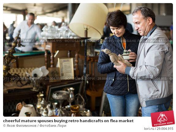 Купить «cheerful mature spouses buying retro handicrafts on flea market», фото № 29004915, снято 23 октября 2017 г. (c) Яков Филимонов / Фотобанк Лори