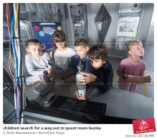 Купить «children search for a way out in quest room bunke», фото № 28730995, снято 21 октября 2017 г. (c) Яков Филимонов / Фотобанк Лори