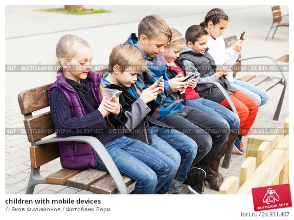 Купить «children with mobile devices», фото № 24931407, снято 10 февраля 2019 г. (c) Яков Филимонов / Фотобанк Лори