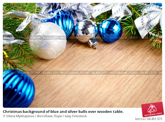 Christmas background of blue and silver balls over wooden table. Стоковое фото, фотограф Olena Mykhaylova / easy Fotostock / Фотобанк Лори