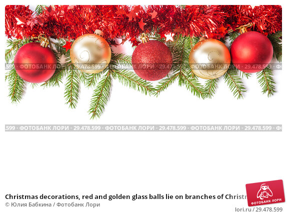 Купить «Christmas decorations, red and golden glass balls lie on branches of Christmas tree, on white background», фото № 29478599, снято 16 ноября 2018 г. (c) Юлия Бабкина / Фотобанк Лори