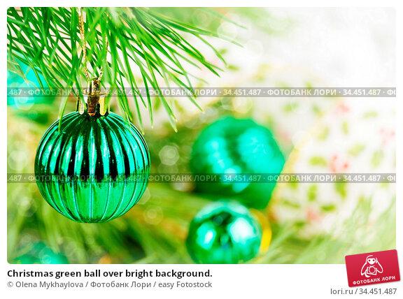 Christmas green ball over bright background. Стоковое фото, фотограф Olena Mykhaylova / easy Fotostock / Фотобанк Лори