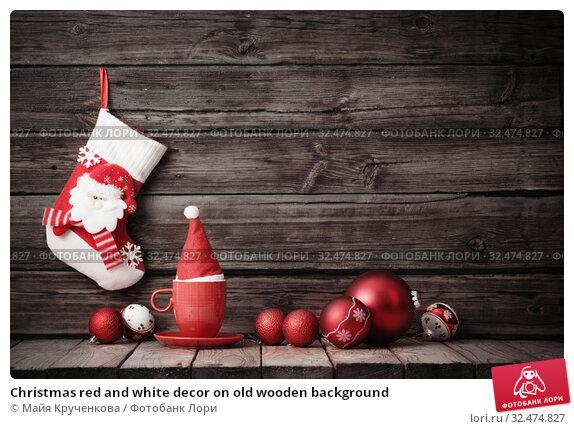 Купить «Christmas red and white decor on old wooden background», фото № 32474827, снято 18 ноября 2019 г. (c) Майя Крученкова / Фотобанк Лори