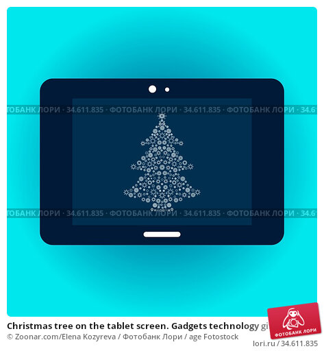 Christmas tree on the tablet screen. Gadgets technology gifts for... Стоковое фото, фотограф Zoonar.com/Elena Kozyreva / age Fotostock / Фотобанк Лори